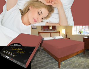 Lady in bed on stretch sheet in color 55-Redwood, bed with deep mattress with Jersey knit stretch sheet in color 55-Redwood