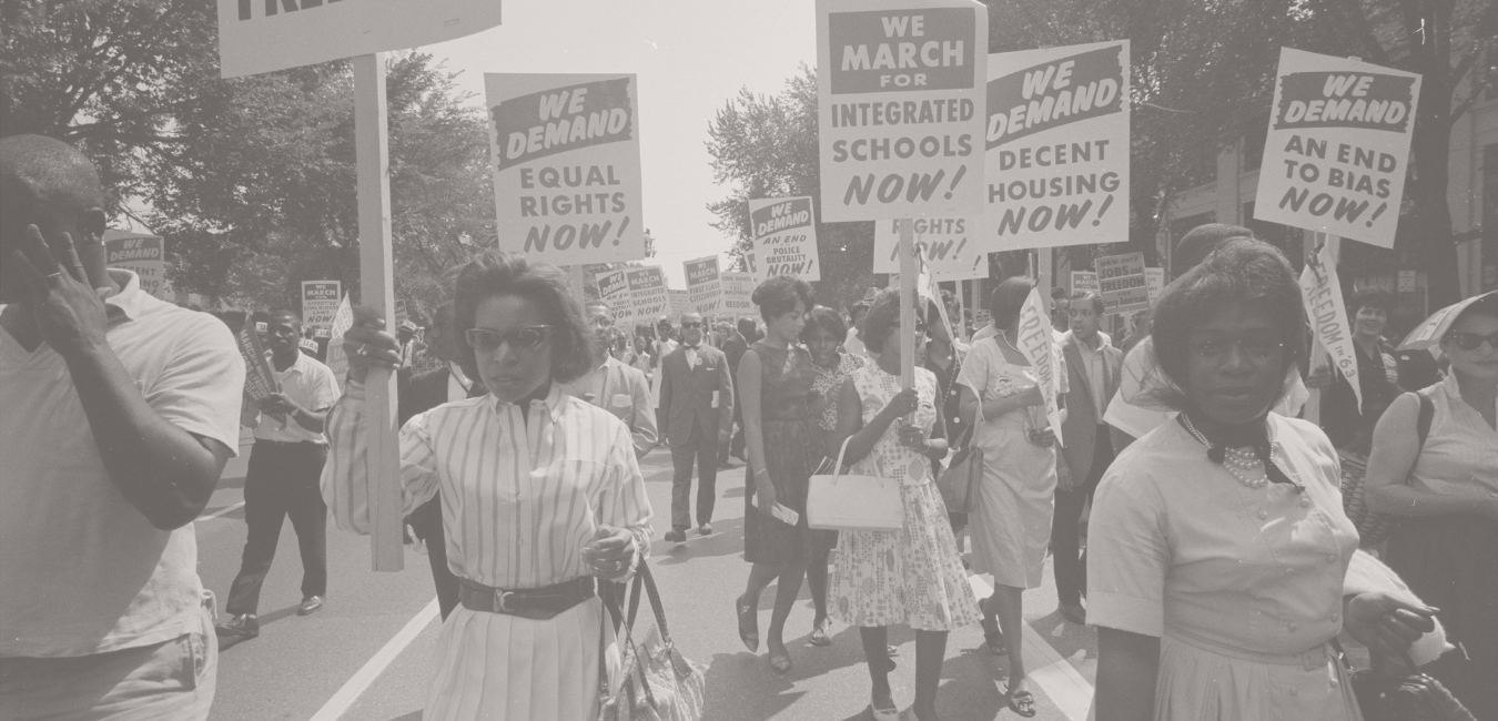 A historical photo showing black women protesting for equal rights and healthcare