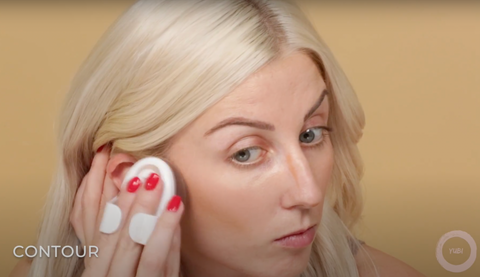 A woman demonstrating how easy it is to contour