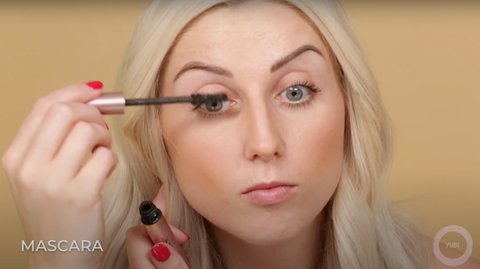 A female beauty vlogger making her eyes pop with mascara