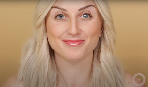 A professional smiling at the camera showing off her easy makeup look