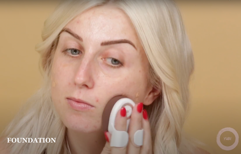 Beauty vlogger applying foundation easily with a Yubi makeup brush