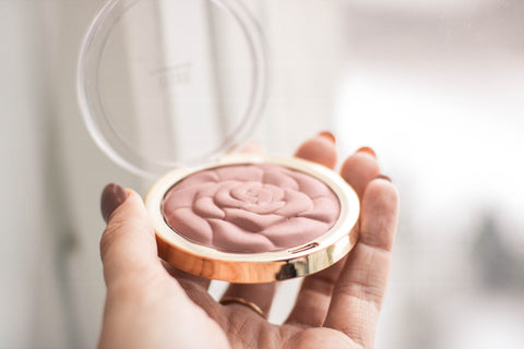 Blush product opened and ready for application to the face
