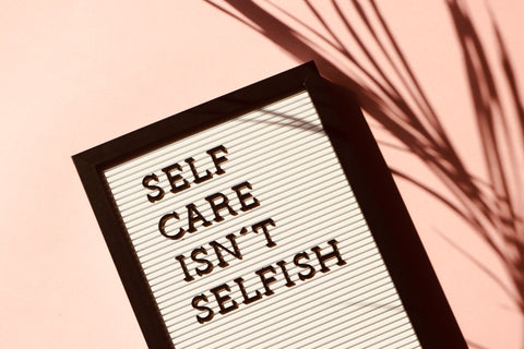 "Quote saying: ""self-care isn't selfish"" it's integral to helping yourself to help others"