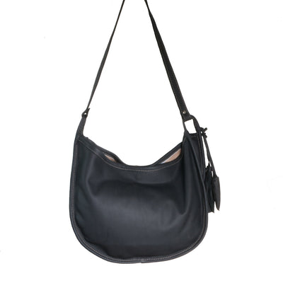Back of Cowhide Moon Bag with Black Leather