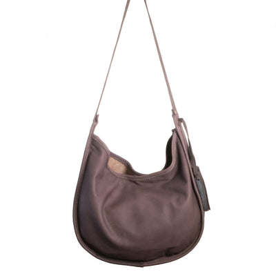 Back of Cowhide Moon Bag with Chocolate Leather