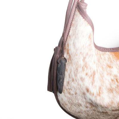 Cowhorn and Tassel Detail on Cowhide Moon Bag with Chocolate Leather
