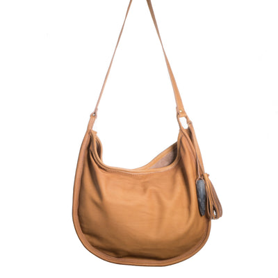 Back of Cowhide Moon Bag with Toffee Leather