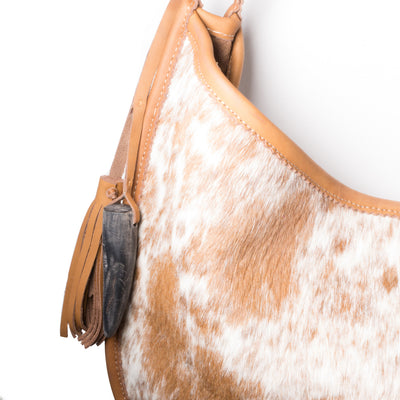 Cowhorn and tassel detail on Cowhide Moon Bag with Toffee Leather