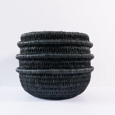 Black coloured, hand made basket / pot