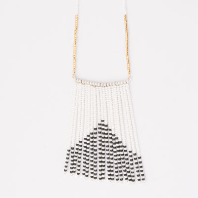 striking necklace hand beaded gold, black and white