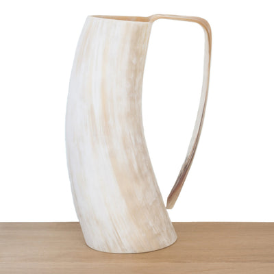 White or ivory coloured Ankole cow horn pitcher or jug with streaks of light brown colour