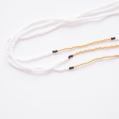 multi stranded glass beaded necklace white and gold