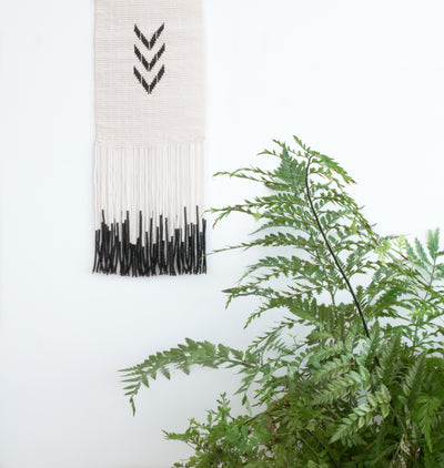 styled, unique black and white beaded wall hanging