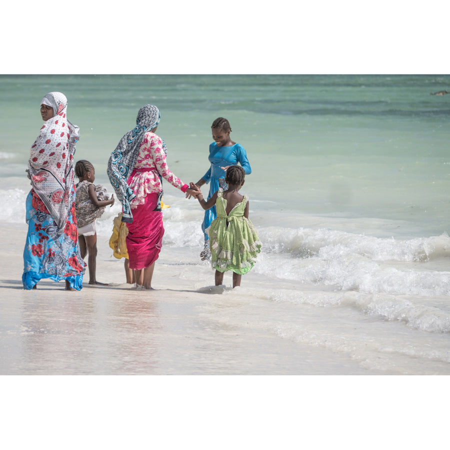 Photograph of women and children on beach not framed