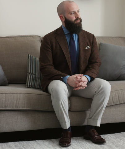 51 Label Style Talk - Dark Brown Donegal Sports Coat with Light Denim Shirt and navy self-stripe tie paired with light brown flannel trousers and dark brown double monk strap shoes