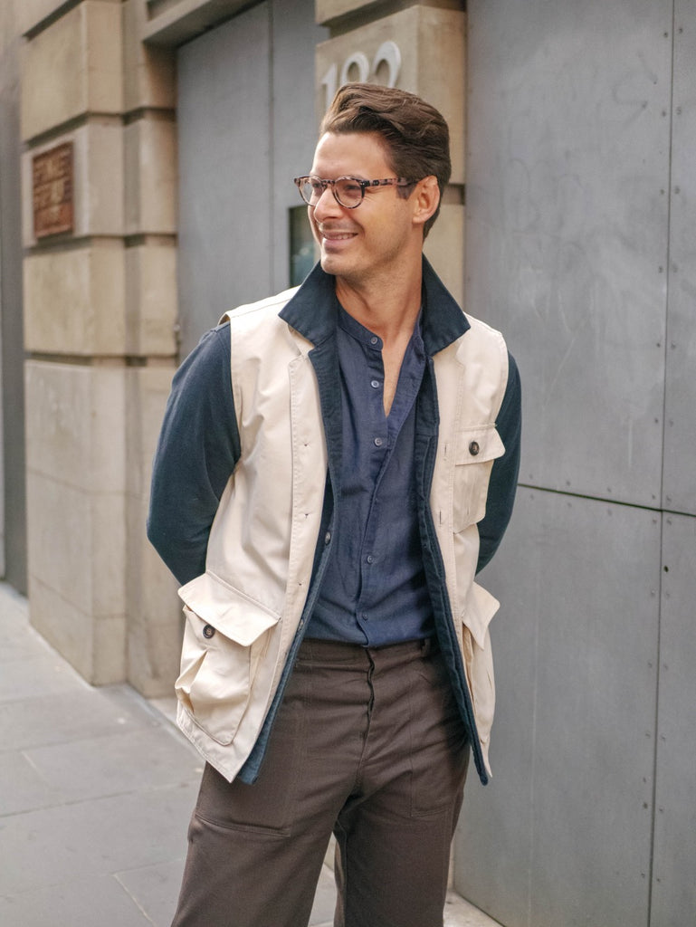 Close_Up_Of_Beige_Utility_Vest_and_Ink_Work_Shirt_Paired_With_Navy_Cotton_Linen_Shirt_and_Chocolate_Fatigue_Pants
