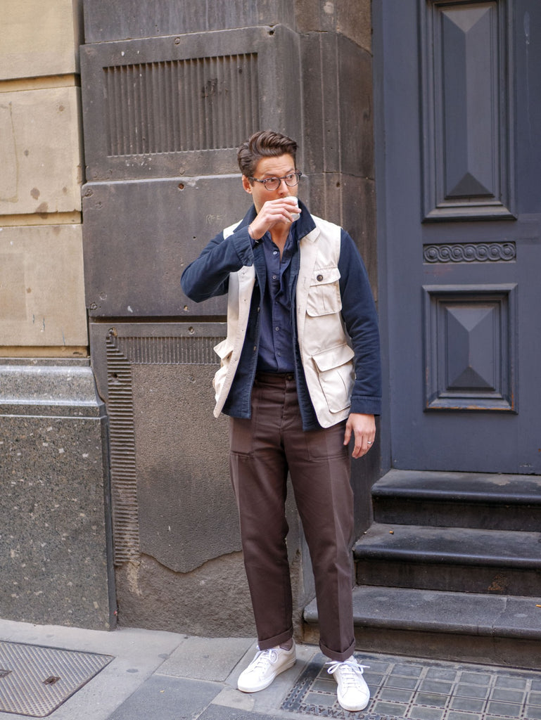 Beige_Utility_Vest_With_Ink_Work_Overshirt_and_Navy_Blue_Cotton_Linen_Shirt_Paired_With_Chocolate_Fatigue_Pants_and_Suede_Yogurt_White_Sneakers_51_Label