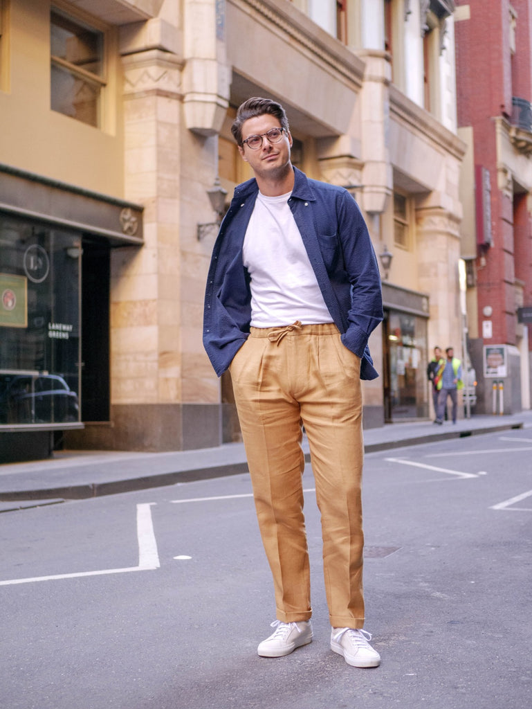 Navy_Blue_Seersucker_Over_Shirt_with_White_T-shirt_and_Caramel_Irish_Linen_Drawstring_Trousers_paired_with_Suede_Yogurt_White_Sneakers_51_Label