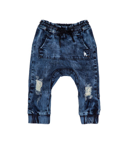 Streetwear style acid wash skinny leg jean, with drop crotch.