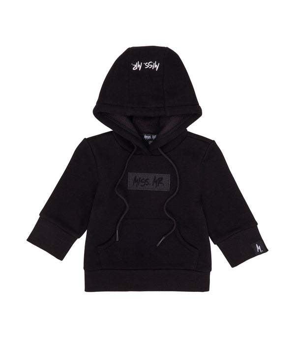 Streetwear style kids black 100% cotton hoodie, with Miss Mr logo embroidered on the front, and a Shaka hand embroidered on the back.