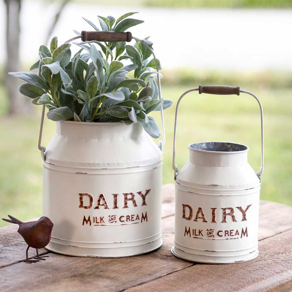white washed farmhouse milk cans