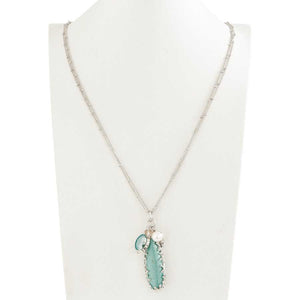 "Antique silver double chain with a 2.5"" long turquoise pendant accompanied by an aquamarine, pearl and crystal charms.  Chain measures 30"" long with a 2.5"" extender."