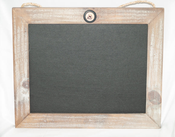 Chalkboard framed in white washed gray barn wood.