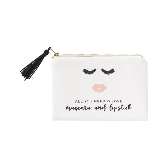 Adorable white cosmetic bag with black tassel zipper pull. Imprinted on the front are lashes + lips with the words
