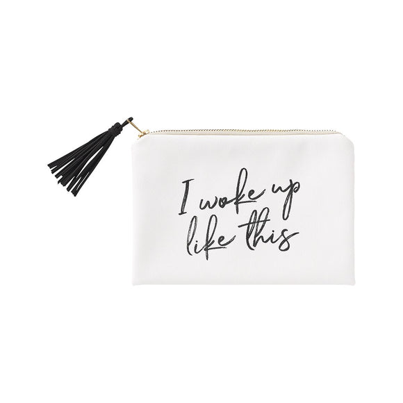 White cosmetic bag with a black tassel zipper pull and the words