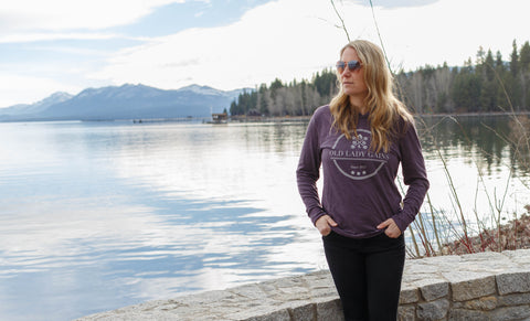 OLG Founder Kim Munoz standing in a purple Old Lady Gains long sleeve t-shirt