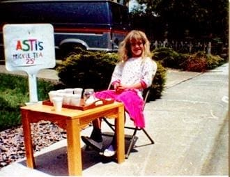 a girl sitting on a table