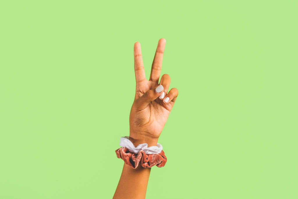 a hand making a peace sign