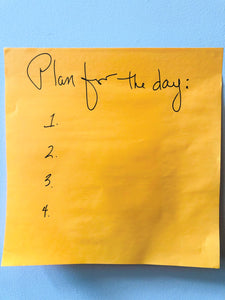 "yellow sticky note with the words ""plan for the day"" with nothing else."