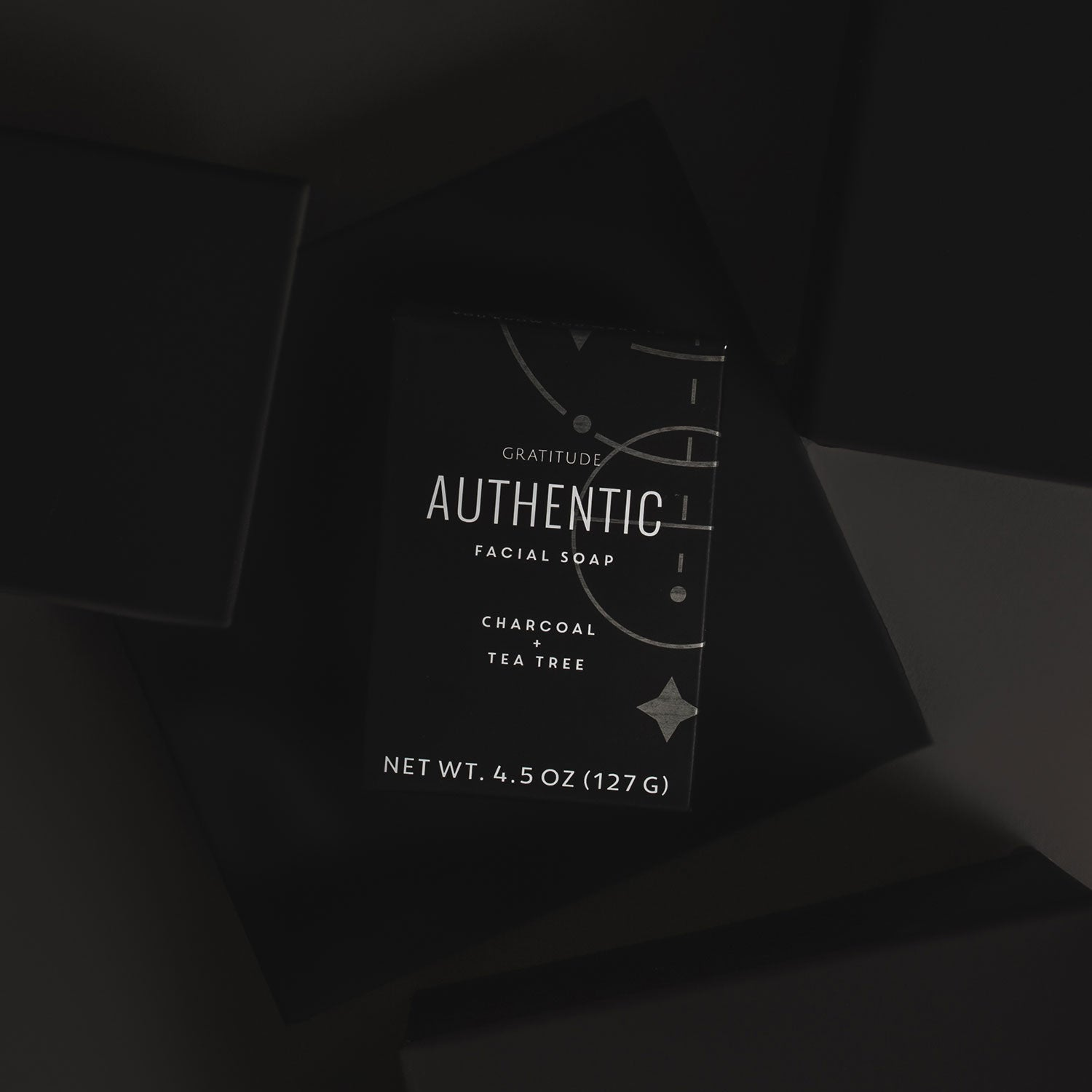 A box of Authentic soap on a black background