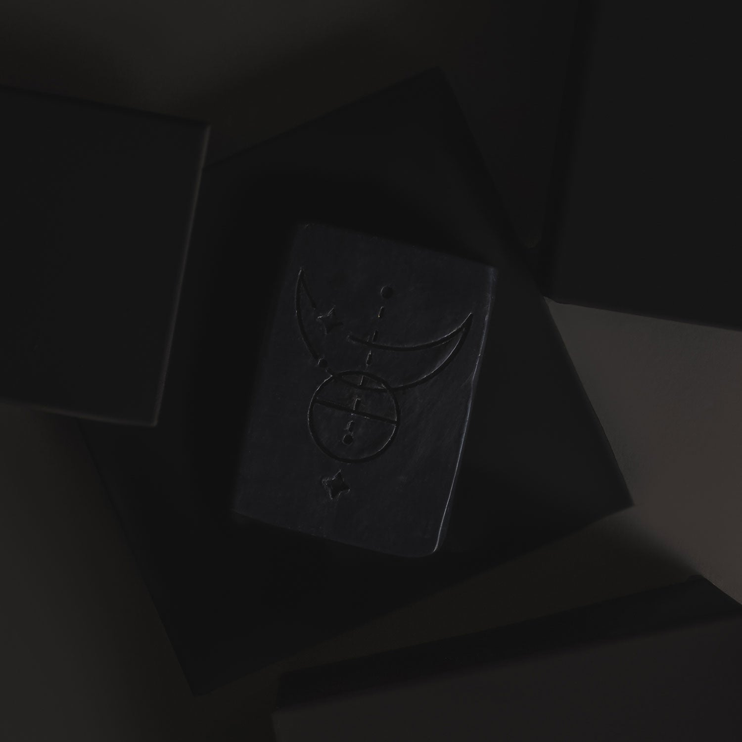 A bar of Authentic soap on a black background