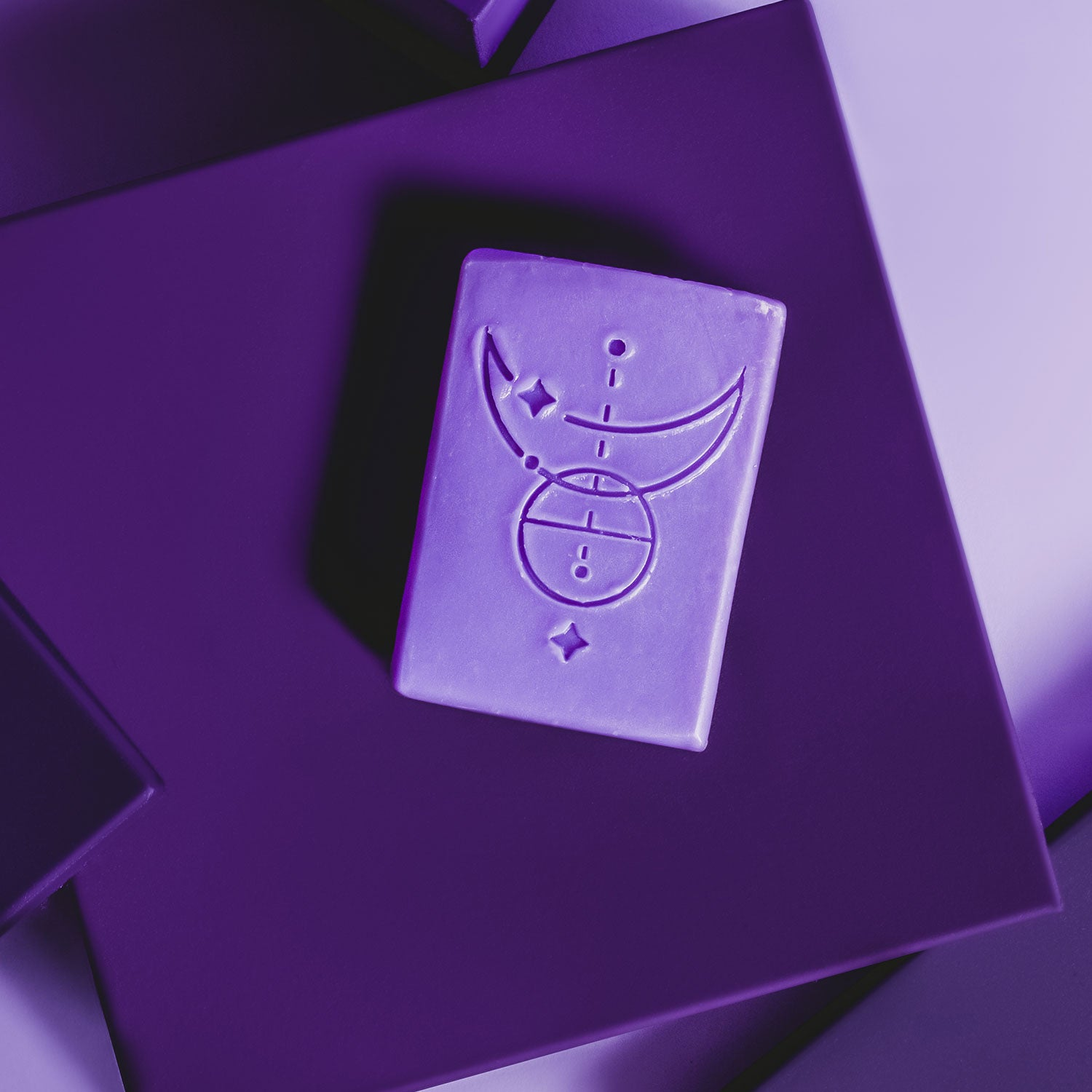 A bar of Comfort soap on a purple background