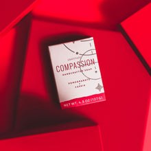a box of compassion soap on a red background