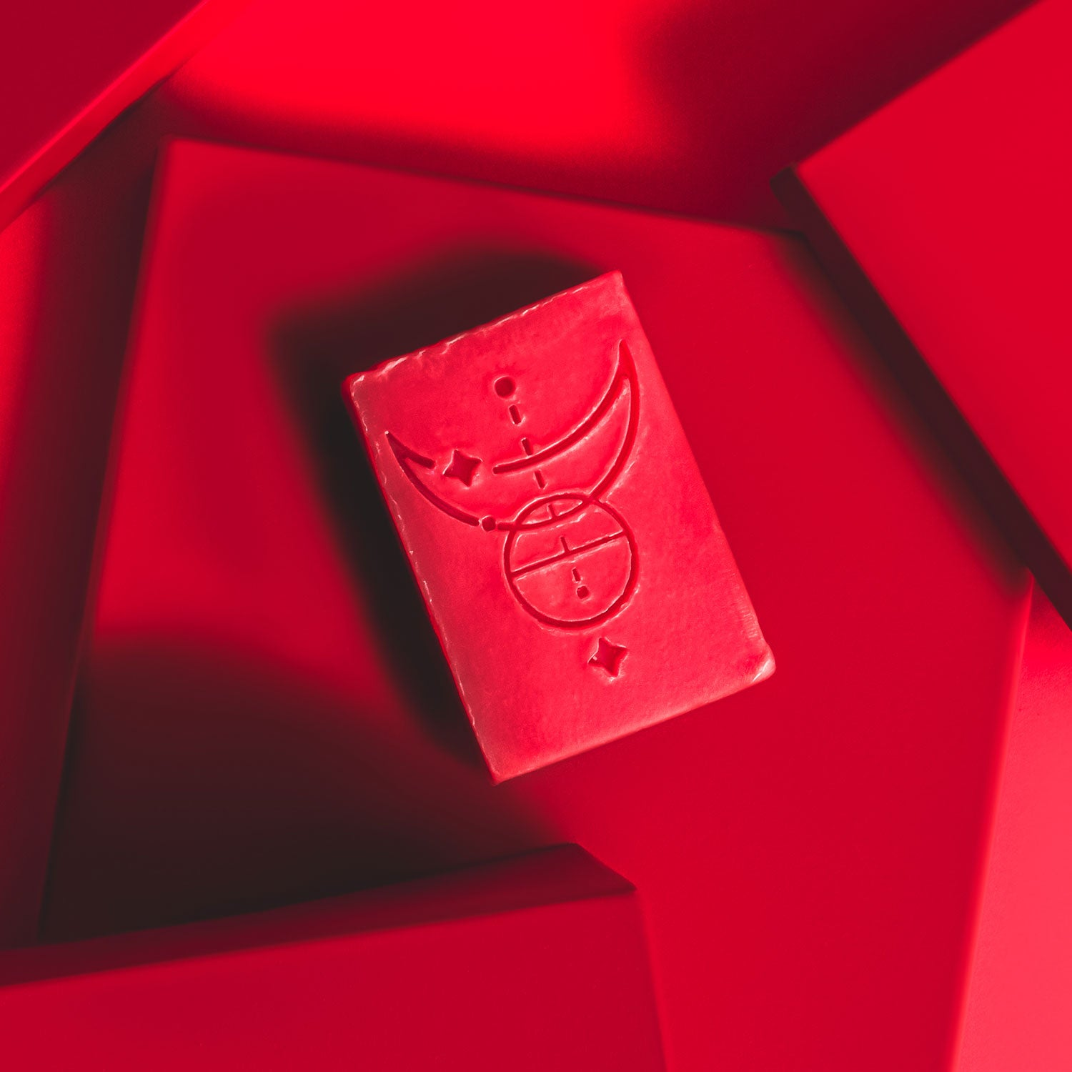 a bar of compassion soap on a red background