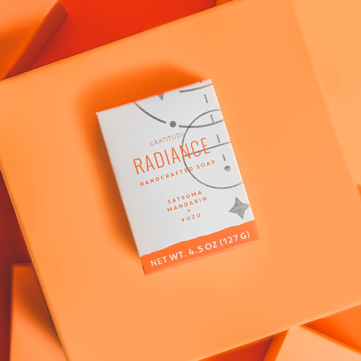 box of radiance soap on an orange background