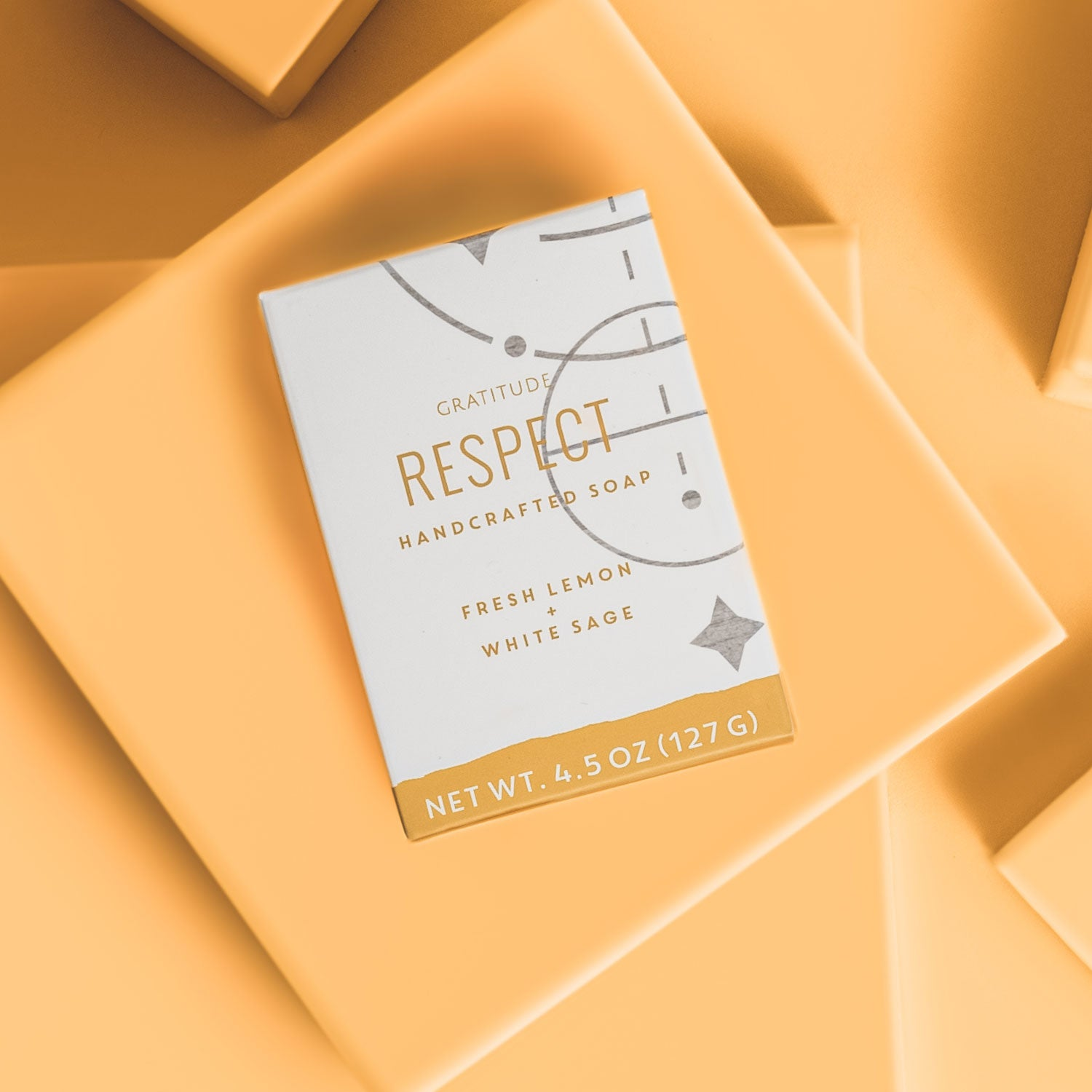 box of respect soap on a yellow background