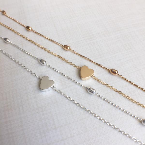 Affordable jewelry never looked this good! Shop our First love choker in gold or silver