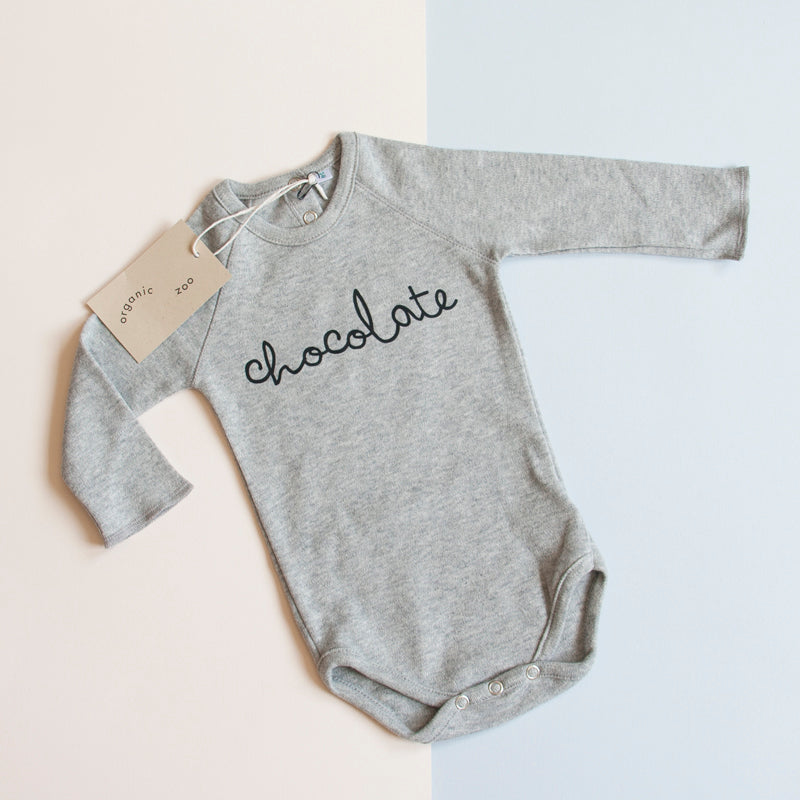 Organic Zoo is a well acclaimed brand for children which has made a name for itself with their playful, minimal and original designs. The Chocolate bodysuit is a good quality piece that will last long and a neutral and useful gift for baby.