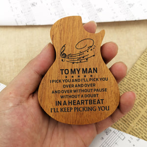 The guitar-shaped wooden box in hand is engraved with meaningful love messages for beloved one