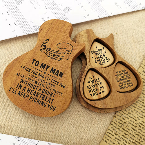 The guitar picks (3 pcs) are placed in a guitar-shaped wooden box and engraved loving messages