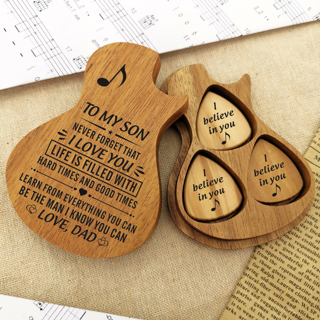 The guitar picks are placed in a guitar-shaped wooden box and engraved loving messages for son