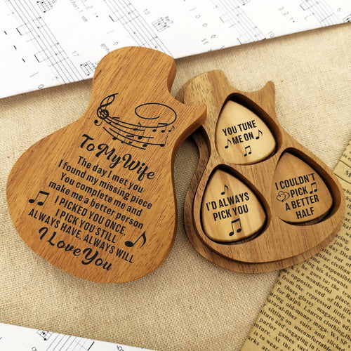 The guitar picks are placed in a guitar-shaped wooden box and engraved loving messages for wife