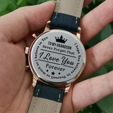 Holding the engraved watch with the perfectly loving messages for grandson