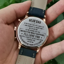 Holding the engraved watch with the perfectly loving messages for dad from daughter