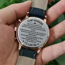 Holding the engraved watch with the perfectly loving messages for husband